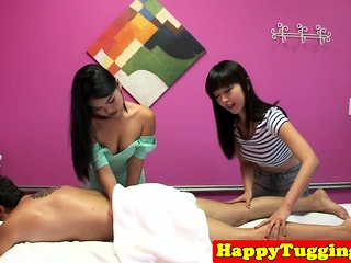 Young asian masseuses jerking clients cock